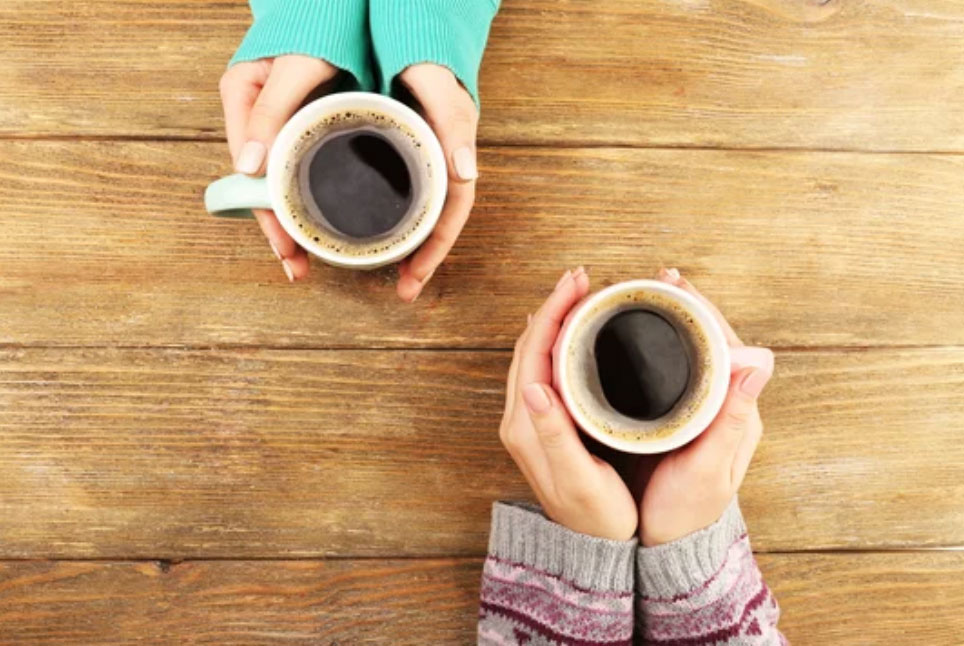 2 hands holding coffee